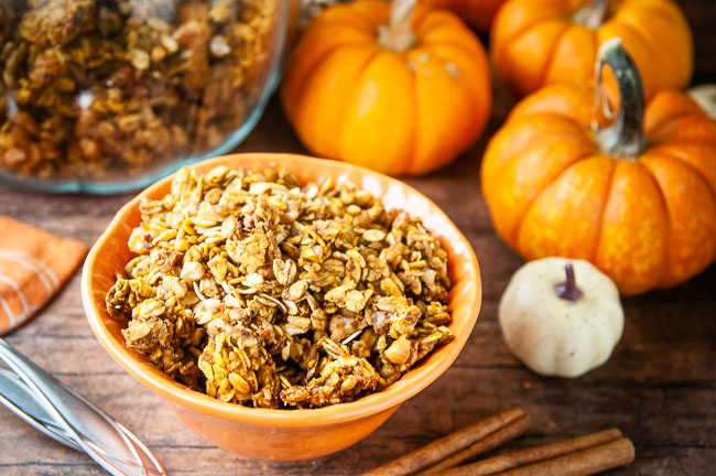 A bowl of pumpkin granola on a cozy fall table