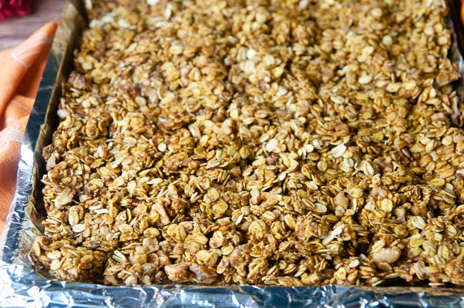 Spread the granola on a sheet pan lined with aluminum foil and sprayed with nonstick spray.