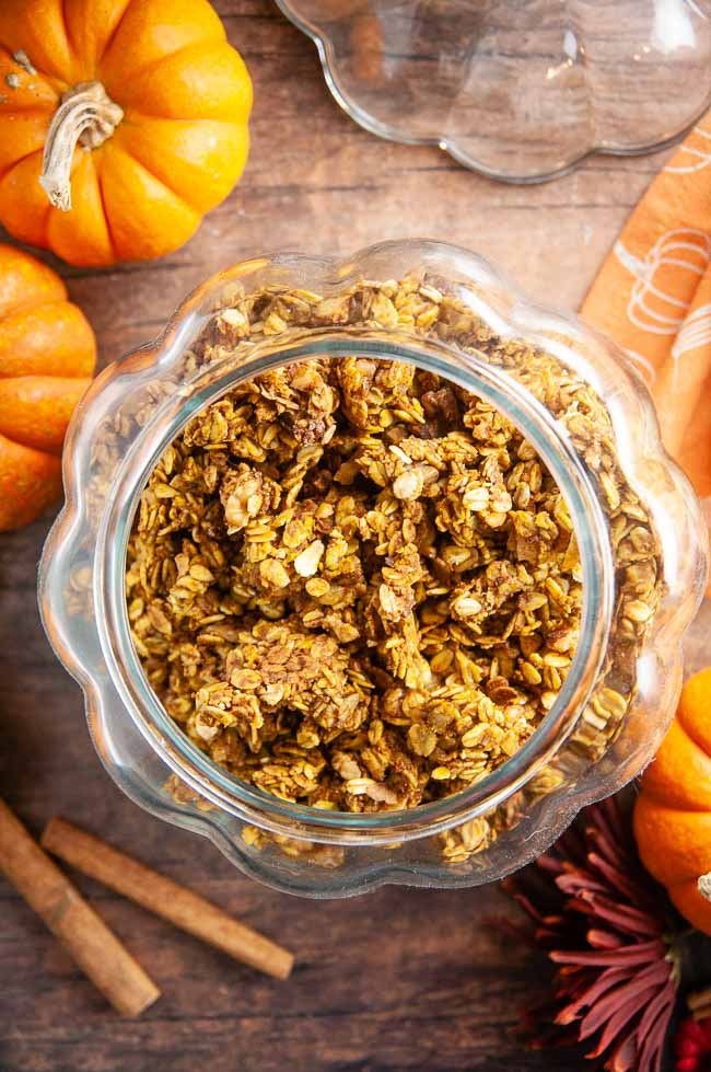 A jar of pumpkin granola on a cozy fall table