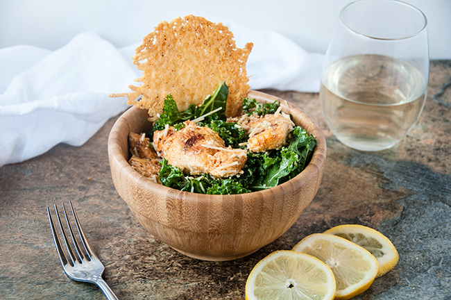 Buffalo Chicken Caesar Salad with Kale and Parmesan Cheese Crisps