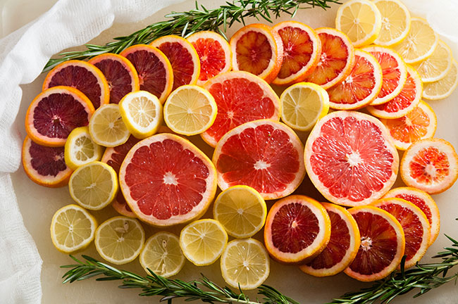 Slices of grapefruit, lemon, and blood oranges