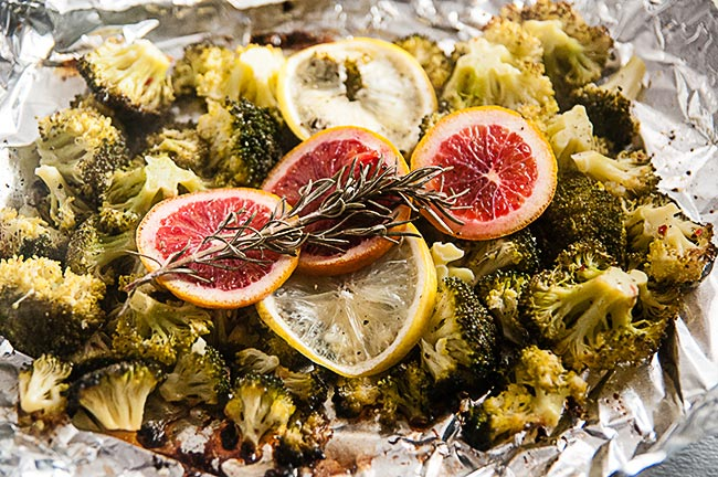 Broccoli ready to be roasted with blood oranges, lemon and rosemary