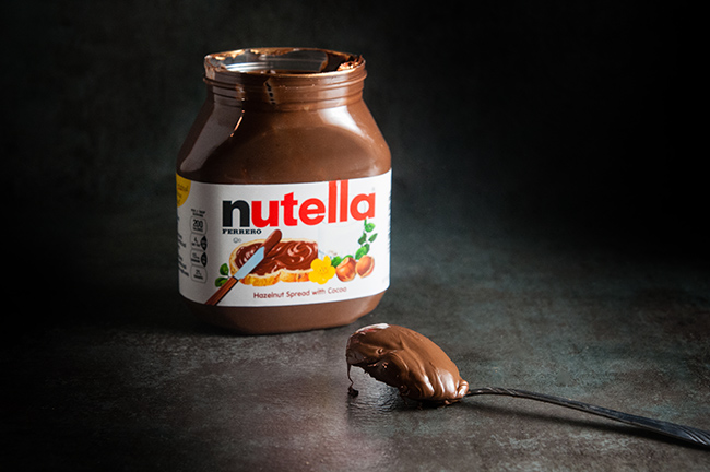 jar of Nutella with a spoon of Nutella