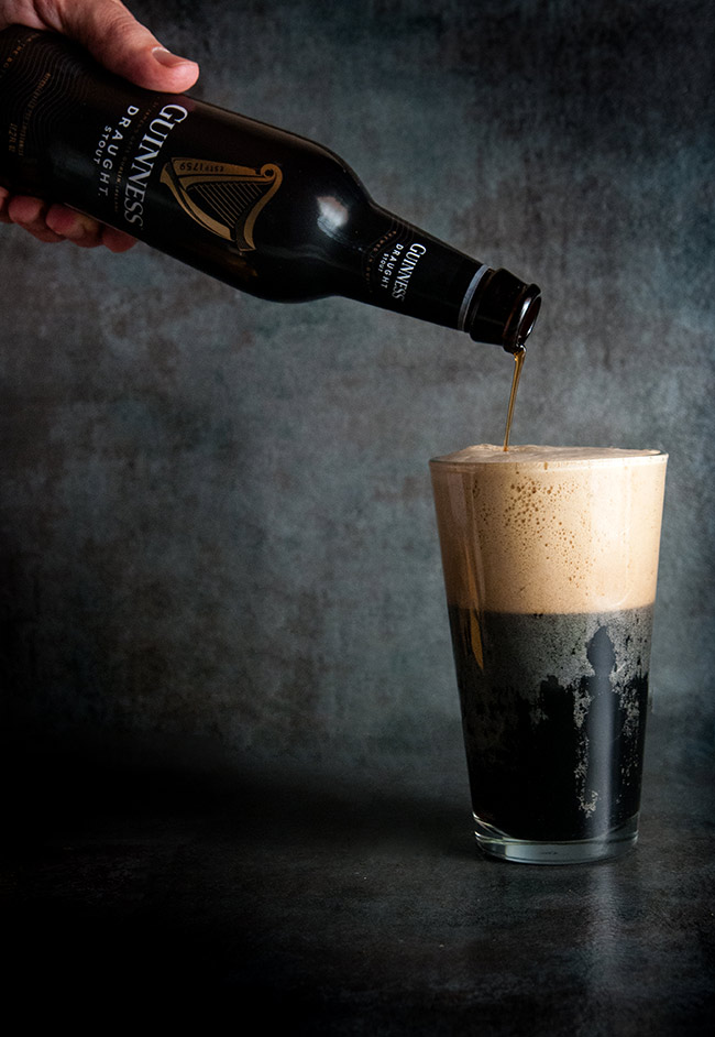 Guinness being poured into a cup
