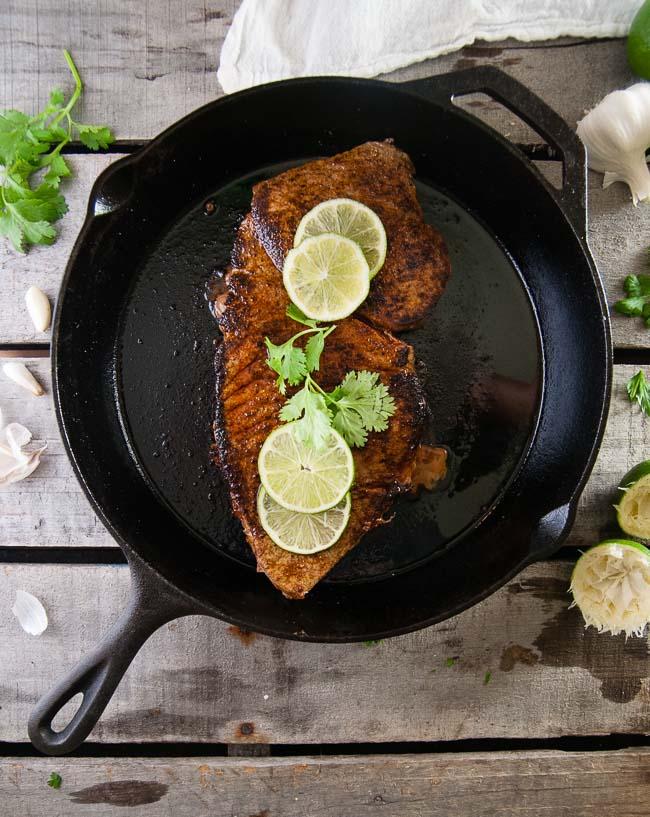 seasoned steak in a cast iron pan