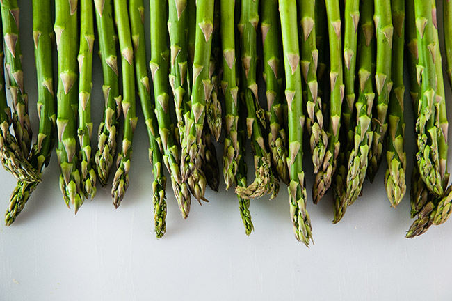 Asparagus spears on white