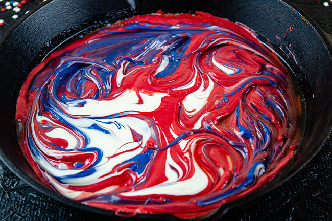 red white and blue melted candy swirled together