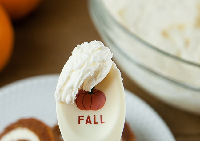 Boozy Pumpkin Spice Buttercream on a paddle that has a pumpkin on it