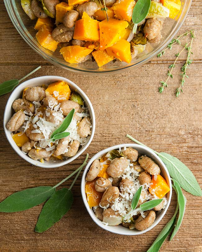 Roasted Sheet Pan Gnocchi and Fall Vegetables on wood with sage and thyme