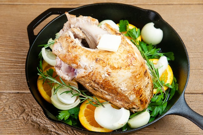 Get the turkey ready for the oven with more butter, olive oil, herbs, and aromatics