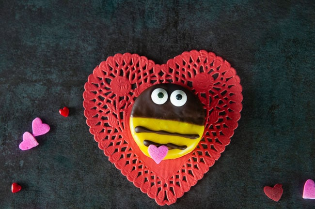bumblebee cookie on red heart on black