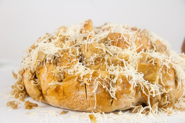 Shredded cheese on pull apart bread