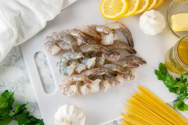 Ingredients for easy shrimp scampi- linguine, shrimp, lemon, garlic, butter