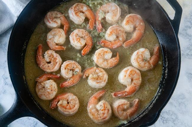 Shrimp scampi cooking in a skillet