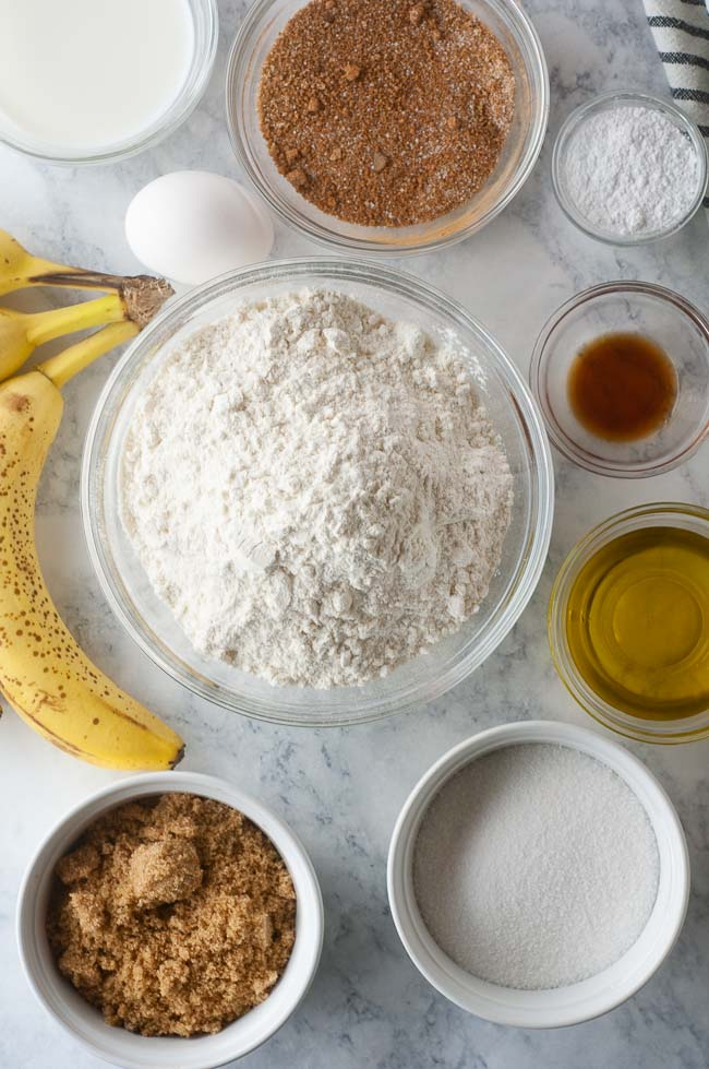 Ingredients for Cinnamon Swirl Banana Bread: overripe bananas, brown and white sugar, baking powder, salt, vanilla, milk, oil, an egg and cinnamon
