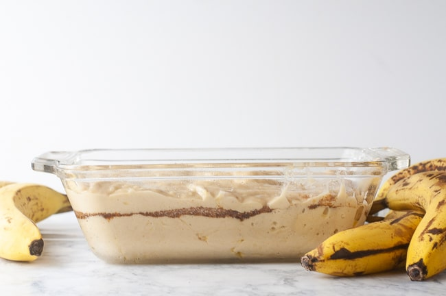 Cover the first layer of banana bread batter with cinnamon swirl and then spread the remaining batter on top of the cinnamon sugar layer