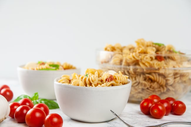 Instant Pot Caprese Pasta is delicious hot or cold served as Caprese pasta salad
