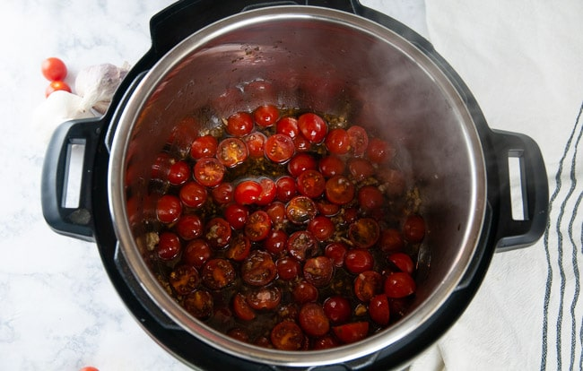 Add the tomatoes, garlic, seasoning and balsamic to olive oil