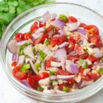 Fresh tomato salsa goes perfectly with chips, tacos or nachos