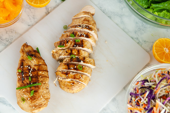 Slice the grilled chicken breasts for the mandarin chicken salad