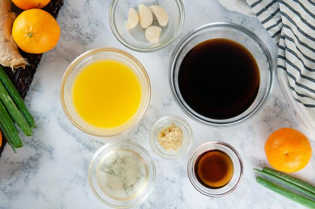 Ingredients Orange Ginger Asian Chicken Marinade: Orange juice, garlic, soy sauce, rice wine vinegar, sesame oil, ginger