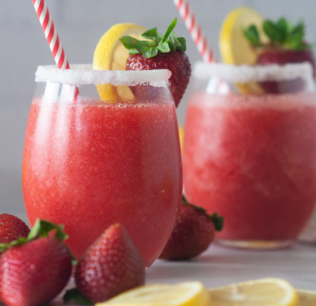 Boozy strawberry lemonade slushies make a fun drink for summer.