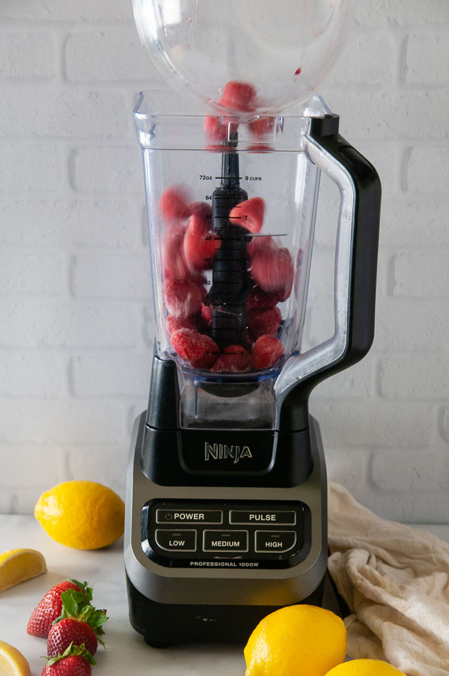 Add the frozen strawberries to your blender
