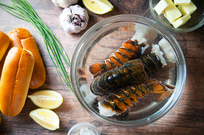 Ingredients for a lobster roll with no mayonnaise: lobster, hot dog rolls, butter, lemon, seasoning