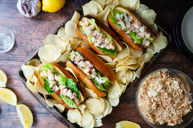 Potato chips and coleslaw pair well with lobster rolls.