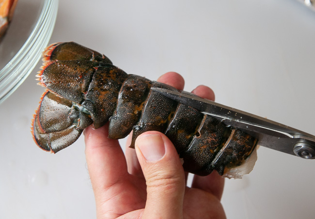 To butterfly lobster tail, cut the middle of the tail with kitchen sheers