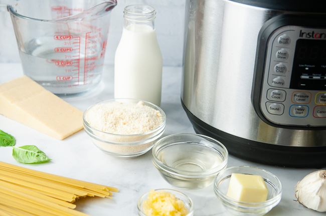 Ingredients for Instant Pot Fettuccine Alfredo: Fettuccine, Parmesan, Heavy Cream, White Wine, Butter, Garlic, Water