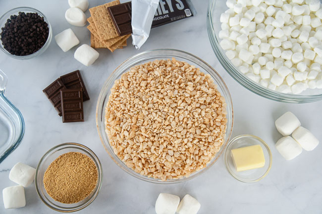 Ingredients for S'mores Rice Krispie Treats: Marshmallows, butter, Rice Krispies, graham cracker crumbs and chocolate chips
