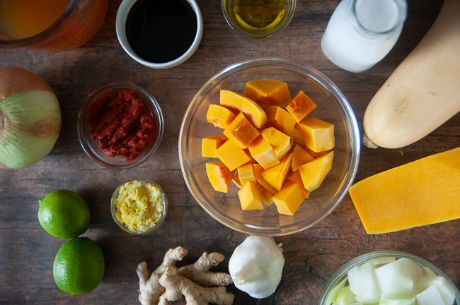 Ingredients for Instant Pot Curried Butternut Squash Soup: butternut squash, soy sauce, coconut milk, garlic, ginger, curry paste, onion, and vegetable broth