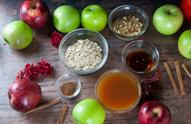 Ingredients for Instant Pot Stuffed Apples: Apples, Rolled Oats, Spices, Maple Syrup, Apple Cider, and Walnuts