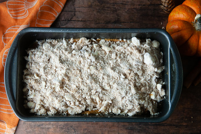 Top the loaf pan full of unbaked pumpkin bread with the streusel topping.