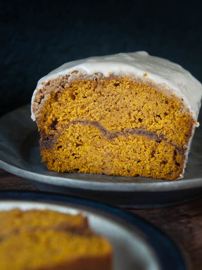 A perfect cinnamon swirl runs through pumpkin bread with streusel topping.