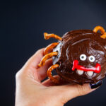 Decorate the cupcake to look like a spider with candy eyes, candy corn pieces, decorator gel and pretzels.