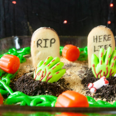 Spooky Graveyard Brownies are a fun food craft to do with the kids this Halloween. Cookies become tombstones and cookie crumbs, spooky sprinkles and edible zombie hands act as decorations.