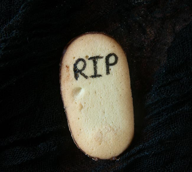 A Milano cookie with RIP written on it to look like a tombstone