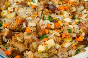 The stuffing in an oven safe dish ready to be baked