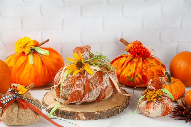 Easy No Sew Fabric Pumpkins on a white background