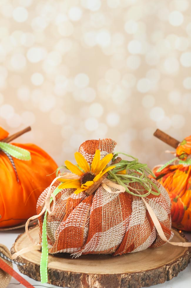 Easy New Sew Fabric pumpkins against a sparkly background on a white counter
