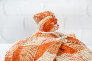 Fabric secured with a rubber band to make a knob for the pumpkin stem