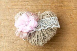 A twine heart on wood.