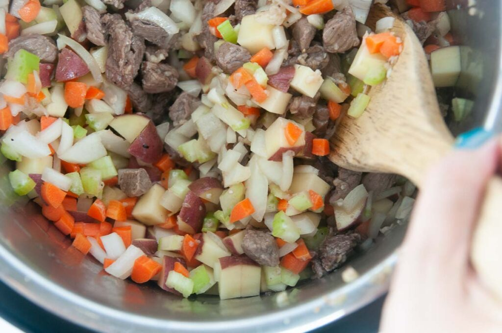 Sear the beef and then soften the veggies in the Inner liner of the Instant Pot.