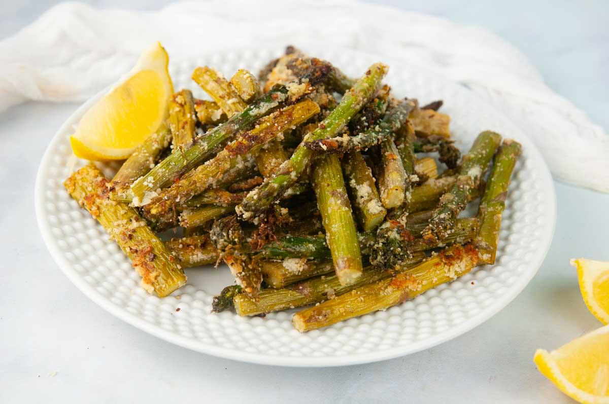 A plate of Flavor Packed Air Fryer Asparagus Tossed with the Perfect Blend of Seasonings
