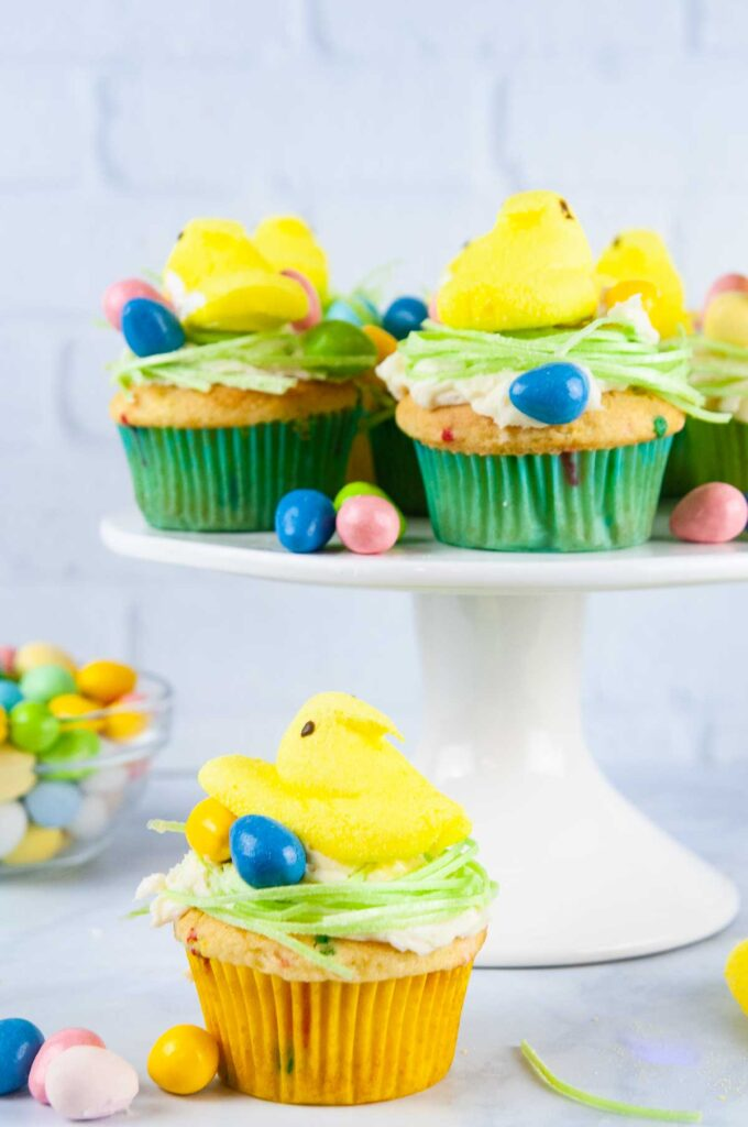 Easter Peeps Cupcakes look like sweet little egg nests with fluffy yellow chicks. Perfect project for the kids.