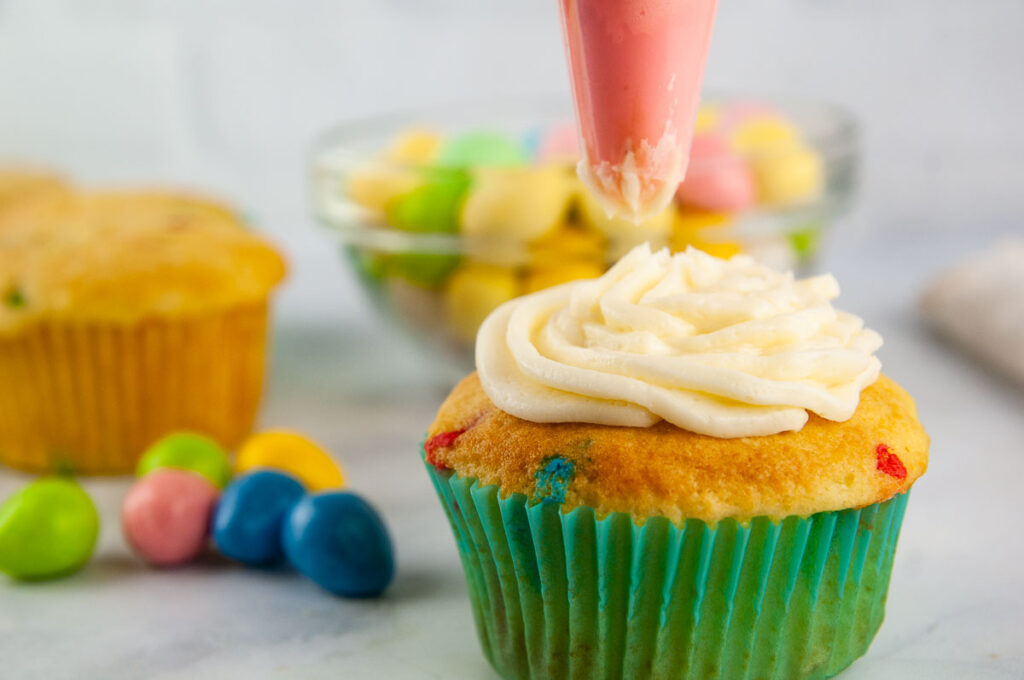 Frost the cupcakes before you decorate them.