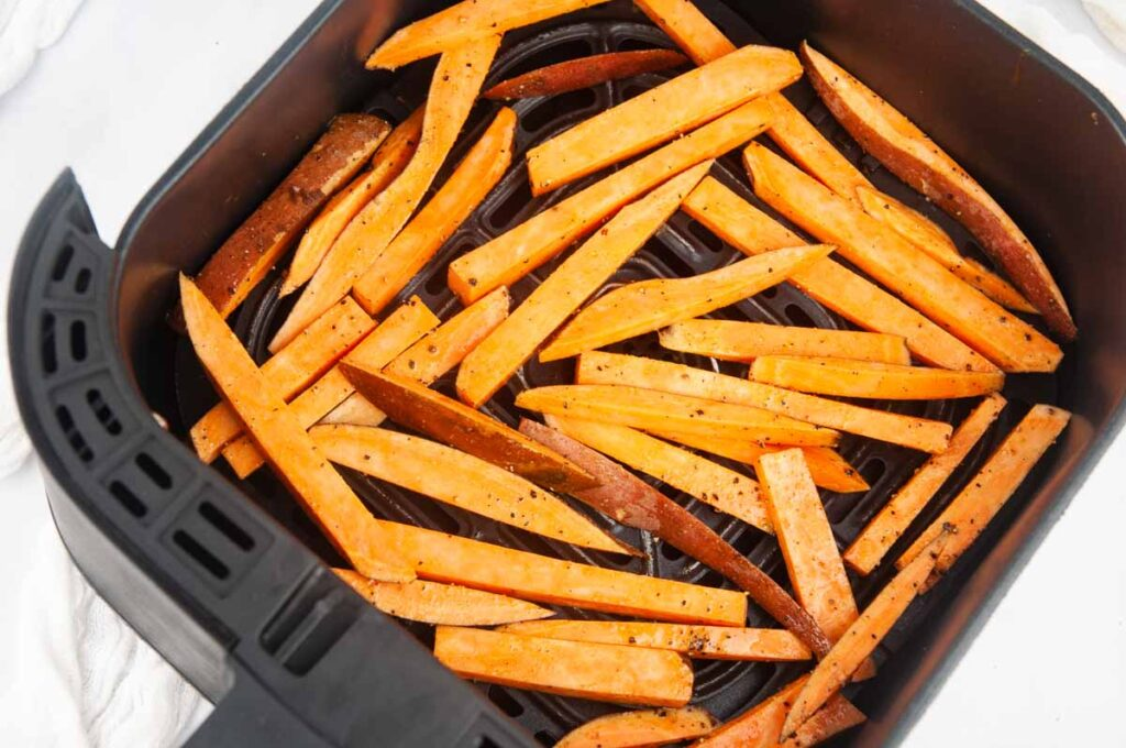 Put the sweet potato fries in the basket of the air fryer, trying to minimize overlapping.