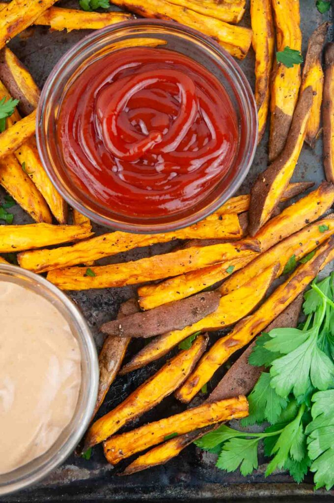 Easy air fryer sweet potatoes are the perfect thing to dunk into ketchup.